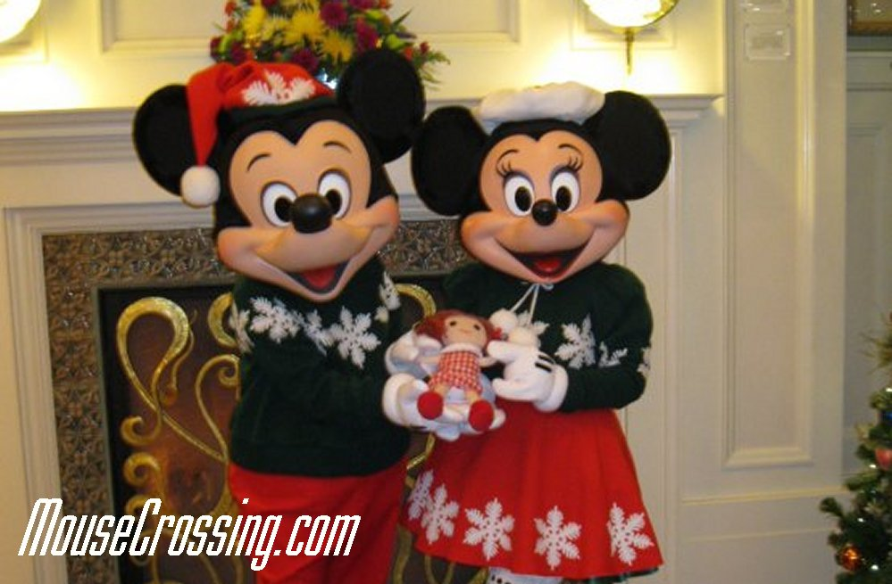 Mickey Mouse and Minnie Mouse in Christmas Sweaters at Board with Misfit Doll