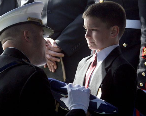 Son accepts flag from fallen Marine father's casket